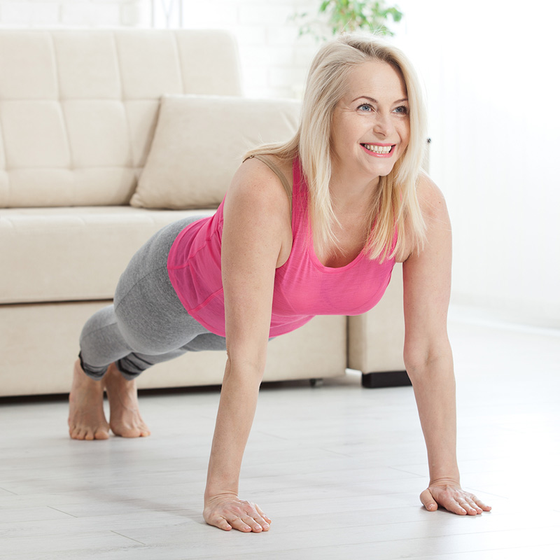woman doing workout class at home